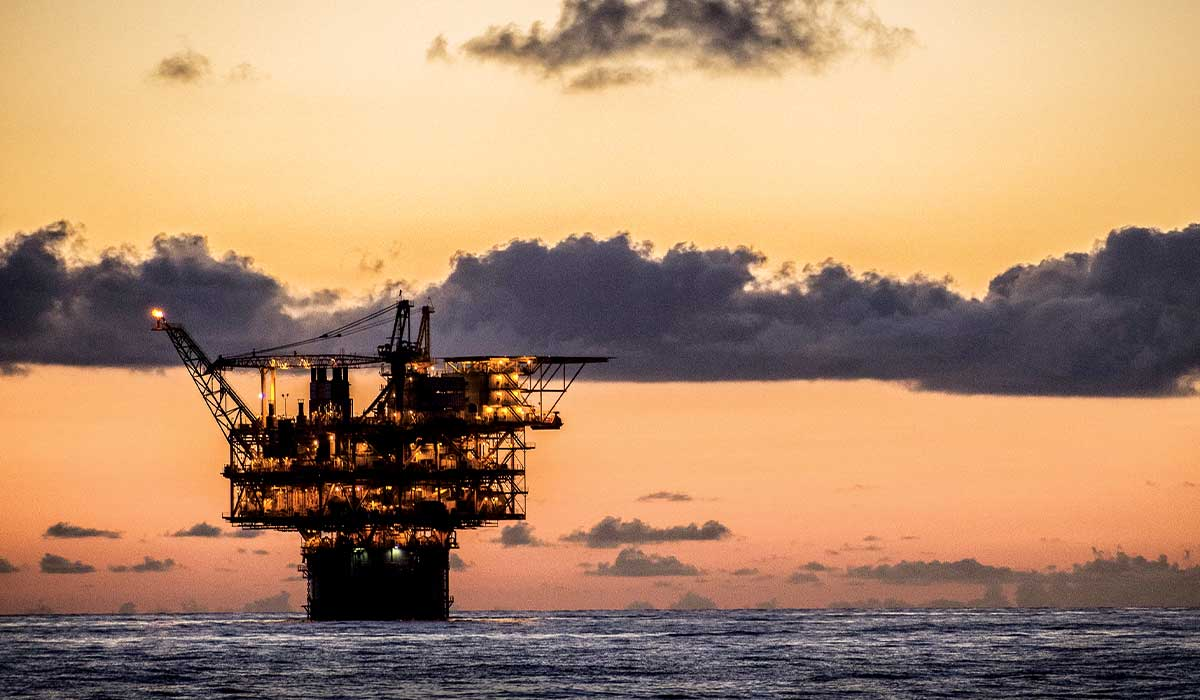 Offshore platform in the ocean at sunset