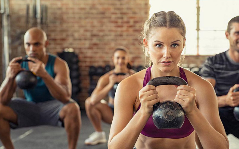 Stock image of woman holding kettlebell