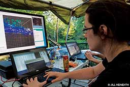 Above water, a programmer tracks the Sunfish vehicle with computer equipment.