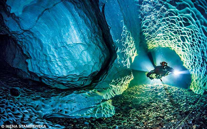 A diver hovers amid the white limestone walls of Dolinsjö Cave in northern Sweden.