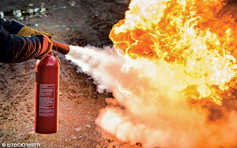 A fire extinguisher is used to extinguish a fire