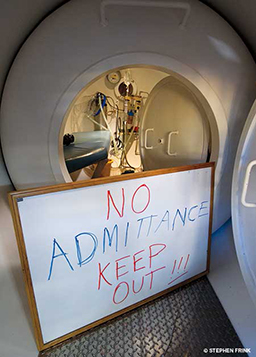 A no admittance sign outside a hyperbaric chamber