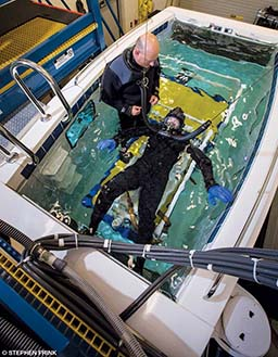 Diver in a tubesuit participates in an experiment