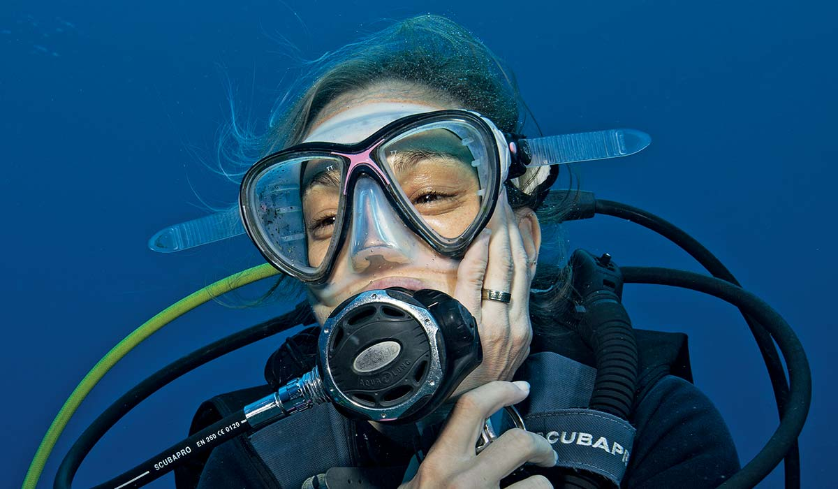 Female diver clutches her mouth