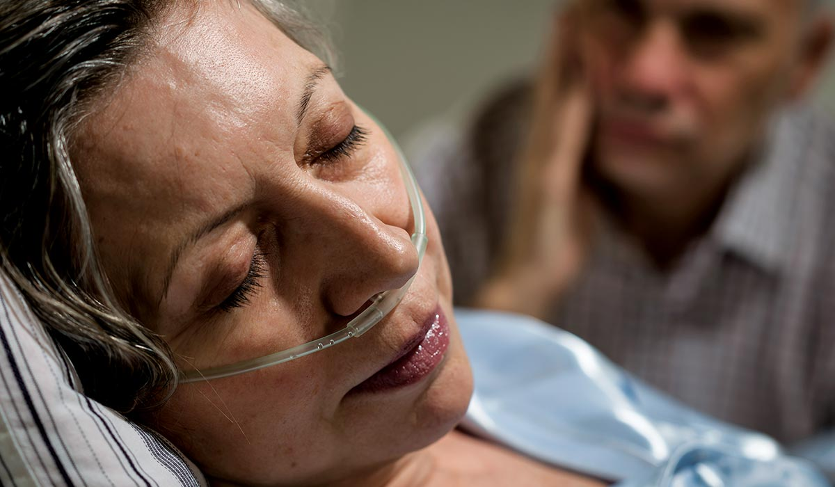 Hospitalized woman closes her eyes to sleep