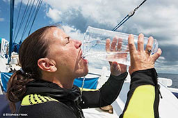 Diver chugs a giant beaker of water