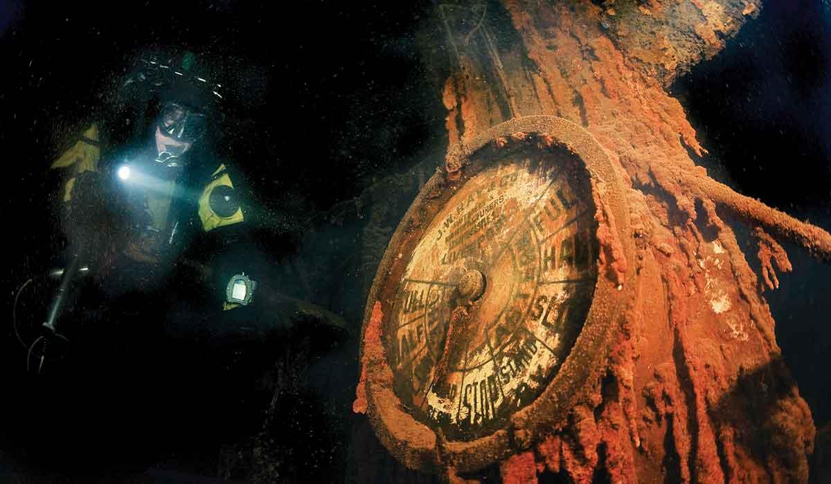 Diver explores the engine room of a shipwreck