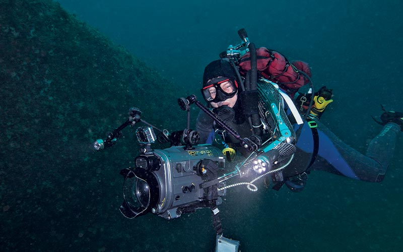 Diver holds a fancy underwater camera