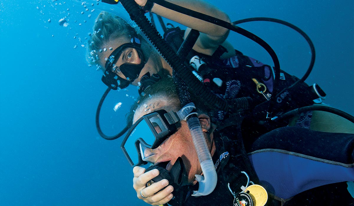 Female diver works hard to tow up an unconscious male diver