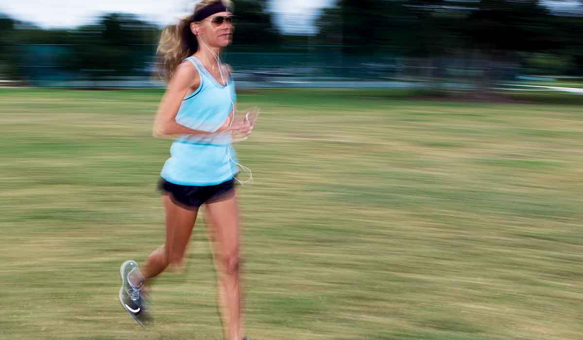 Female running so fast she blurs the image