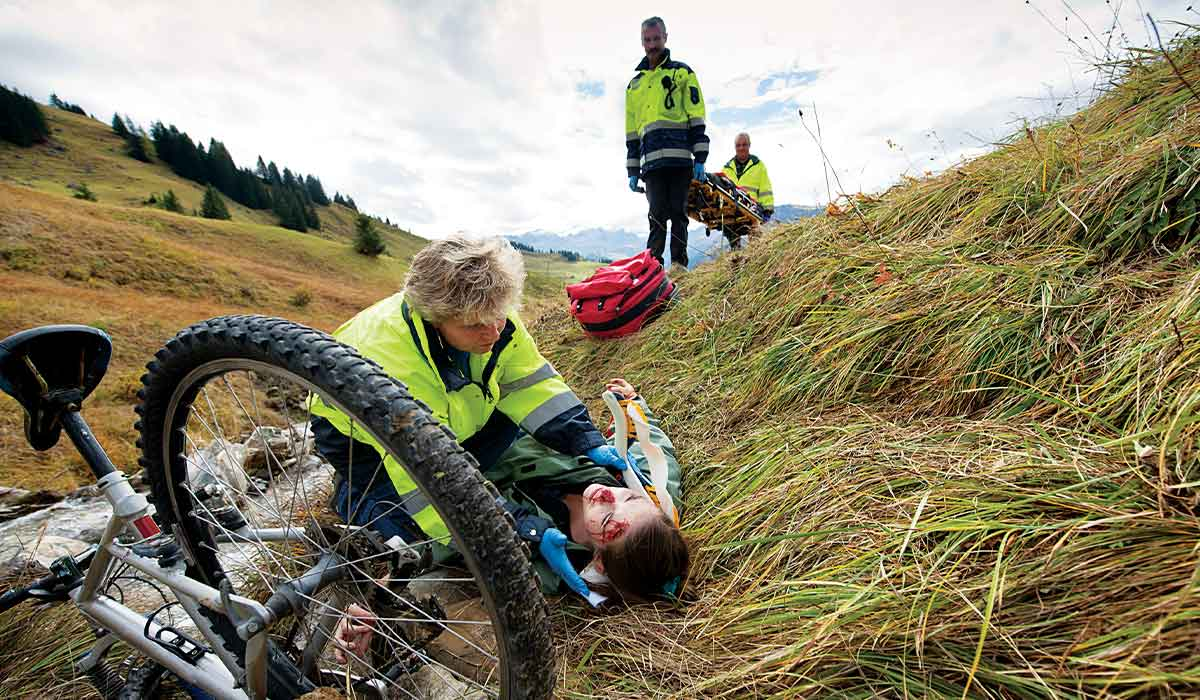 Paramedics tend to a cyclist with a head injury