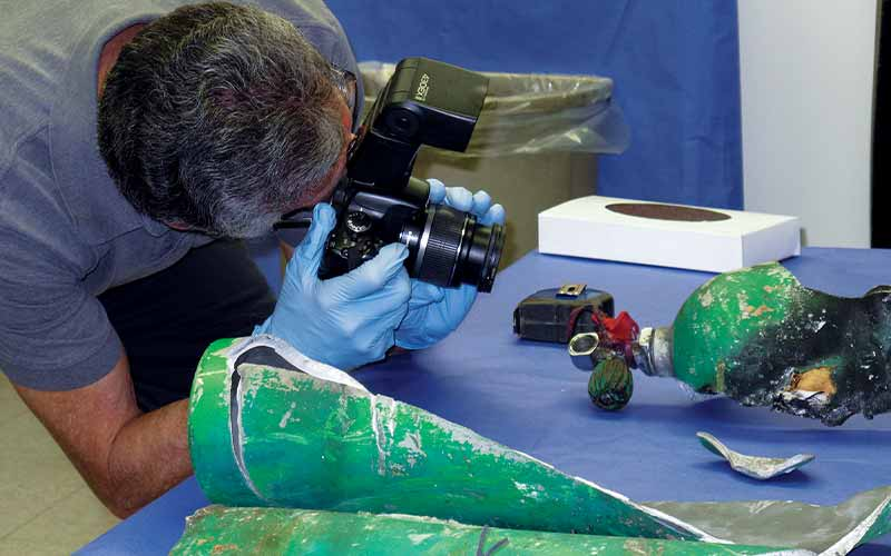Photographer shoots a damaged scuba tank