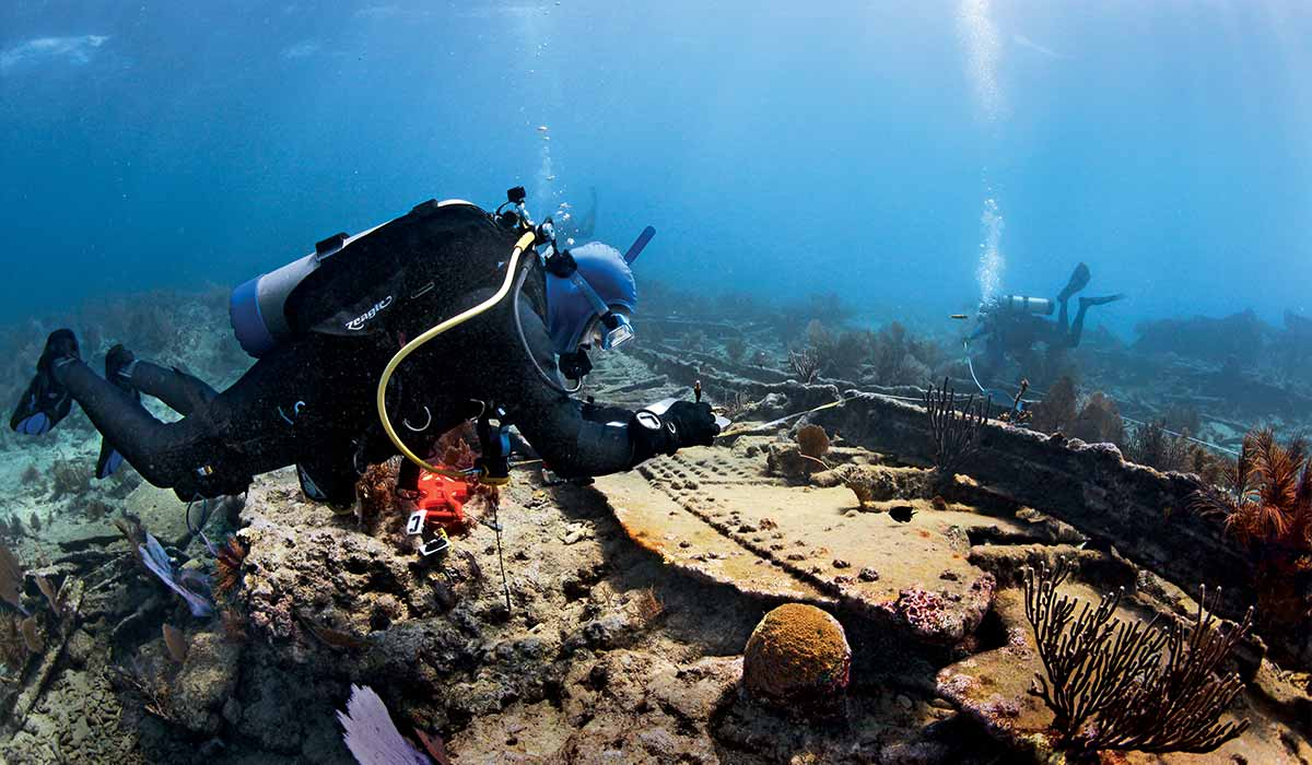 Volunteer diver takes notes on a shipwreck