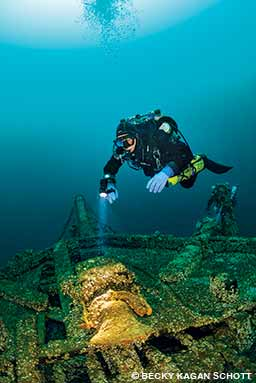 A diver wearing dry gloves