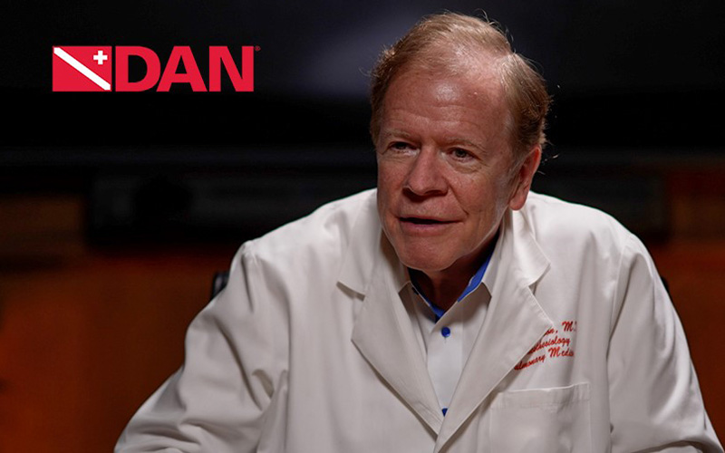 DAN-branded headshot of Dr. Richard Moon wearing a white lab coat