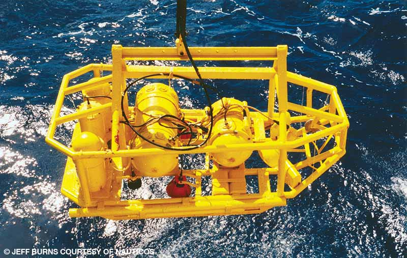 The Russian open-frame camera sled NEPTUN, carrying video and still cameras, gets lowered from the Yuzmorgeologiya to survey the wreck site.