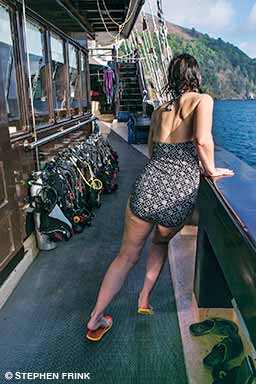 woman experiencing seasickness on a boat