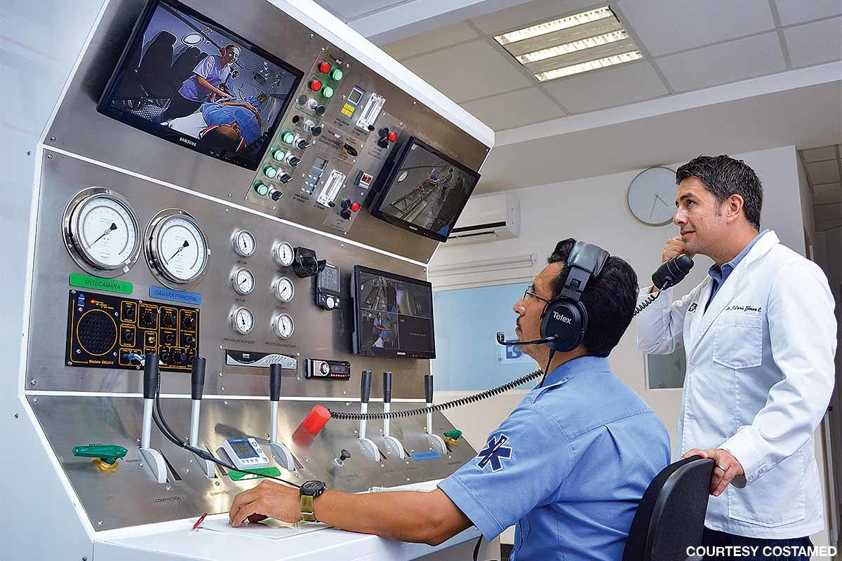 Staff members monitor and communicate with patients at the Costamed chamber.