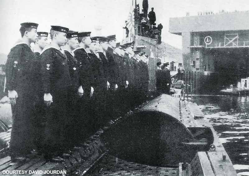 Submariners aboard the I-8 stand at attention as the vessel arrives in German-occupied France on Aug. 31, 1943.