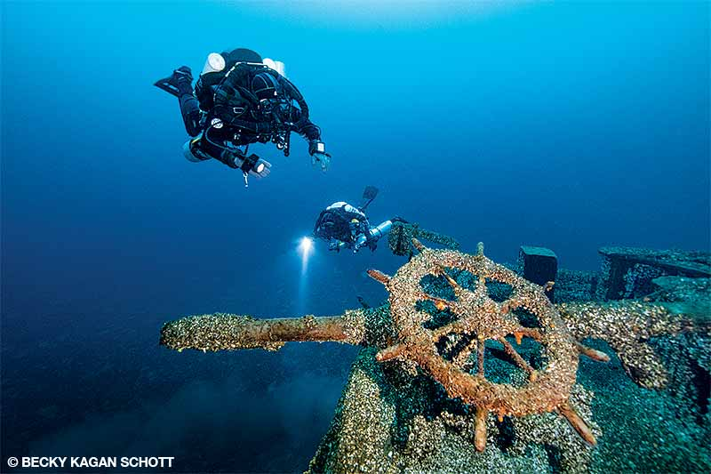The wooden wheel on the stern of the Cornelia B. Windiate is one of the first things divers see as they descend to the wreck.