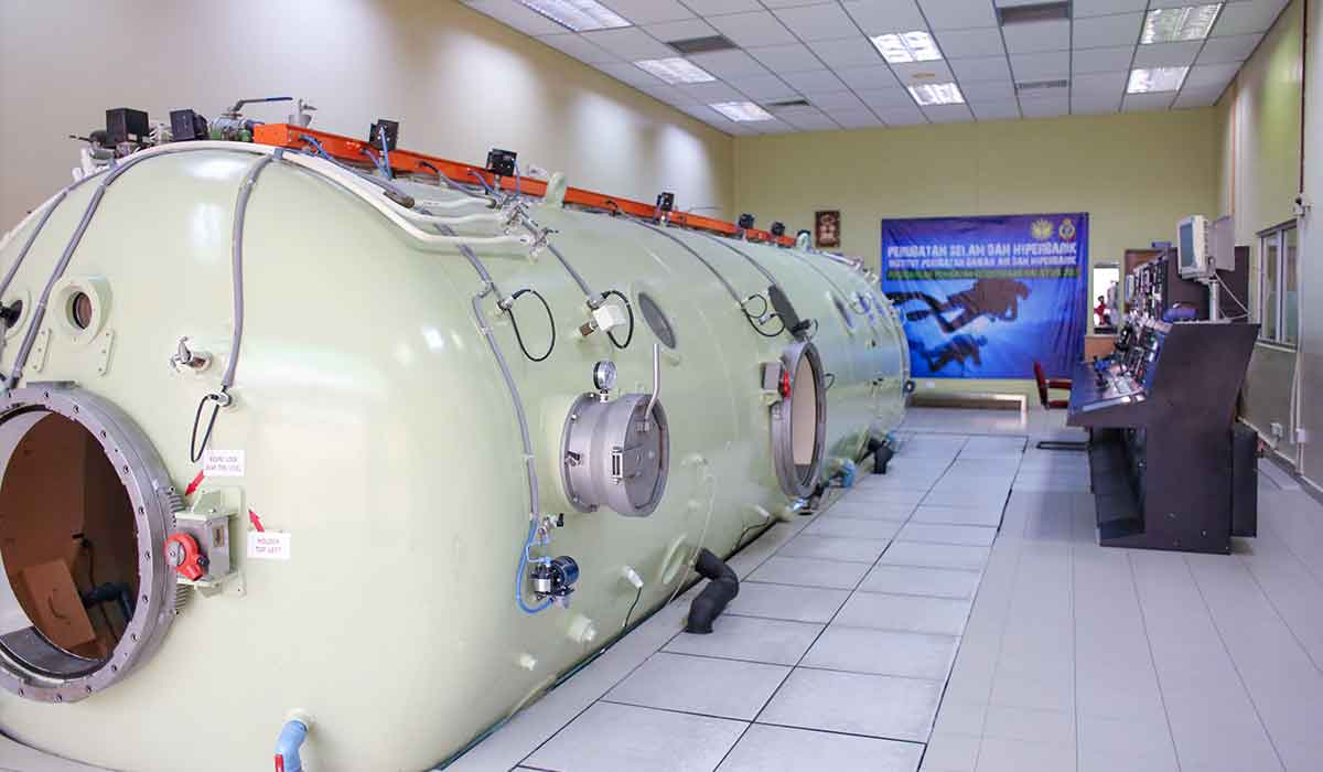 Cream-colored hyperbaric chamber is ready for use