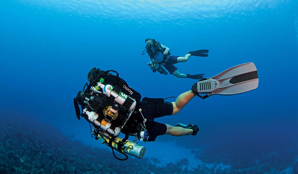 Two rebreather divers practice their skills in the ocean